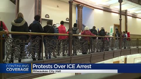Protesters rally to prevent Milwaukee police from partnering...